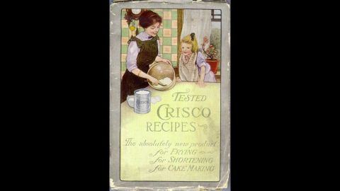 """Procter & Gamble<a href=""""http://www.crisco.com/About_Crisco/History.aspx"""" target=""""_blank"""" target=""""_blank""""> introduced </a>Crisco to consumers in 1911 to """"provide an economical alternative to animal fats and butter."""" The vegetable shortening was the first manufactured food product to contain trans fat."""