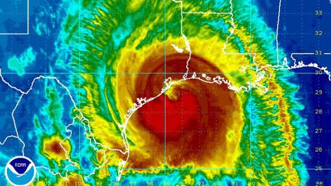 This image provided by NOAA taken at 11:45 p.m. EDT Friday Sept. 12, 2008 shows Hurricane Ike approaching the coast of Texas. At 11 p.m. EDT, Ike was centered about 55 miles southeast of Galveston, moving at 12 mph. It was close to a Category 3 storm with winds of 110 mph, and was expected to strengthen by the time the eye hit land. Because of the hurricane's size, the state's shallow coastal waters and its largely unprotected coastline, forecasters said the biggest threat would be flooding and storm surge, with Ike expected to hurl a wall of water two stories high _ 20 to 25 feet _ at the coast. (AP Photo/NOAA)