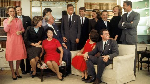 The night after John F. Kennedy won the 1960 presidential election this family portrait was made in Hyannis Port, Massachusetts. Sitting, from left, Eunice Shriver (on chair arm), Rose Kennedy, Joseph Kennedy, Jacqueline Kennedy, head turned away from camera, and Ted Kennedy. Back row, from left, Ethel Kennedy, Stephen Smith, Jean Smith, President John F. Kennedy, Robert F. Kennedy, Pat Lawford, Sargent Shriver, Joan Kennedy, and Peter Lawford.