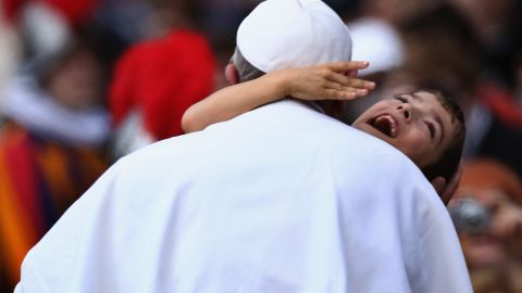 """Francis embraces a young boy with cerebral palsy in March 2013 -- a gesture that many took as a heartwarming token of the Pope's self-stated desire to """"be close to the people."""""""