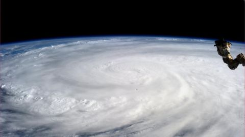 This image provided by NASA shows Typhoon Haiyan taken by Astronaut Karen L. Nyberg aboard the International Space Station Saturday Nov. 9, 2013. Rescuers in the central Philippines counted at least 100 dead and many more injured Saturday a day after one of the most powerful typhoons on record ripped through the region, wiping away buildings and leveling seaside homes in massive storm surges, then headed for Vietnam. (AP Photo/NASA, Karen L. Nyberg)