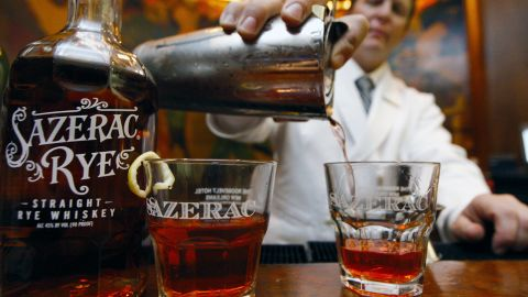 """New Orleans is the """"undisputed cocktail capital of the South,"""" according to """"The Southerner's Handbook,"""" and no visit to the Big Easy should go without trying a Sazerac. This cognac-based beverage packs a punch, but a lemon twist should help offset the absinthe."""