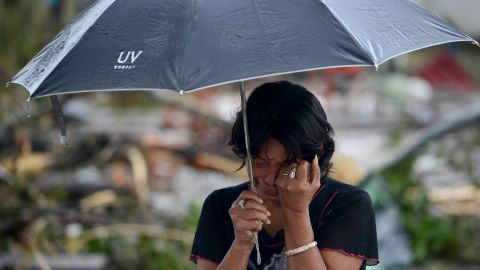 A woman mourns in front of her husband's dead body in a street of Tacloban, eastern island of Leyte on November 10, 2013. The Pentagon said it was providing the Philippines with naval and aviation resources in the wake of a devastating typhoon. The UN said that it expected the provisional 1,200 death toll from super typhoon Haiyan to rise and is sending emergency supplies to the stricken country. AFP PHOTO/NOEL CELIS (Photo credit should read NOEL CELIS/AFP/Getty Images)