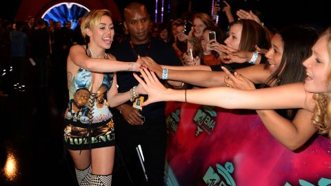 Miley Cyrus meets fans as she attends the awards at the Ziggo Dome in Amsterdam.