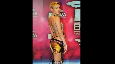 Miley Cyrus sports her outfit upon her arrival.