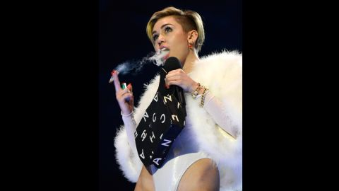 """Miley Cyrus accepts the award for best video for her song """"Wrecking Ball"""" during the 2013 MTV Europe Music Awards in Amsterdam, Netherlands, on Sunday, November 10. Click through the gallery to see more scenes from the awards and celebrity arrivals:"""