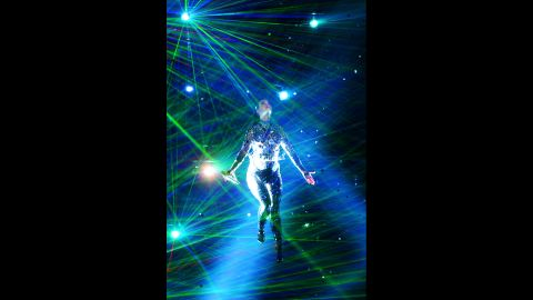 Bathed in blue light, Katy Perry performs.