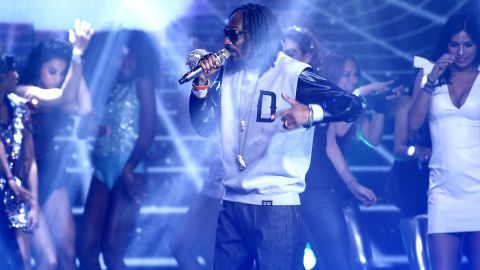 """Snoop Dogg performs his classic """"Gin and Juice"""" during the outside broadcast."""