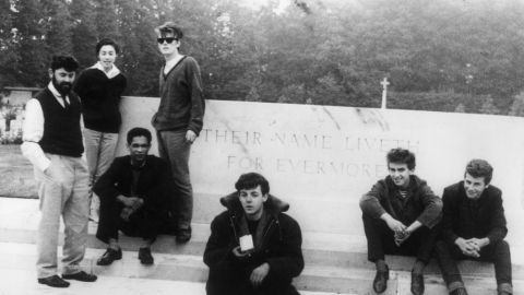"""<strong>Stu Sutcliffe was a terrible bassist.</strong> Though Sutcliffe (standing, third from left) was no McCartney, he went from complete neophyte to solid rhythm player during the band's Hamburg days. He left the job because he wanted to pursue his painting, and McCartney remembers being """"lumbered with"""" the position as new bassist."""
