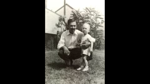 """Turner, seen here with his father at approximately 2 years old, was born to Florence and Robert Edward """"Ed"""" Turner II. Turner's father ran a billboard advertising business."""