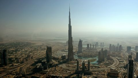 An aerial view shows Burj Dubai (C), the world's tallest tower built by Emaar property developer, in the Gulf emirate of Dubai on December 17, 2009. Dubai faces financial difficulties due to debts estimated at between 80 and 100 billion dollars. The emirate announced on November 25 that it sought a six-month debt moratorium for state-owned conglomerate Dubai World, sparking global fears of a Dubai debt default. AFP PHOTO/MARWAN NAAMANI (Photo credit should read MARWAN NAAMANI/AFP/Getty Images)