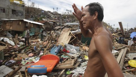 A man looks at his destroyed home November 13 in Tacloban.