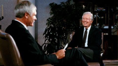 Turner talks with former U.S. President Jimmy Carter in 1989.