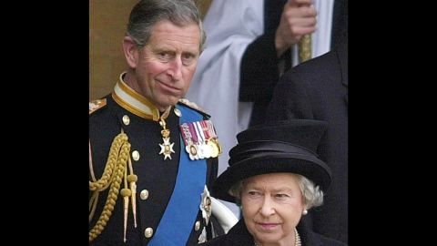 """LONDON, UNITED KINGDOM:  (FILS) A file photo taken 05 April 2002 shows Britain's Queen Elizabeth II (R) leaving Westminster Hall followed by Britain's Prince Charles after the coffin of Britain's Queen Mother was placed there to lie in state. The queen stunned royal observers 23 February 2004 by announcing she would not attend Prince Charles' civil wedding to his longtime companion Camilla Parker Bowles. """"The queen will not be attending the civil ceremony because she is aware that the prince and Mrs. Parker Bowles wanted to keep the occasion low-key,"""" said Buckingham Palace, her official London residence.    AFP PHOTO POOL/RICHARD LEWIS  (Photo credit should read RICHARD LEWIS/AFP/Getty Images)"""