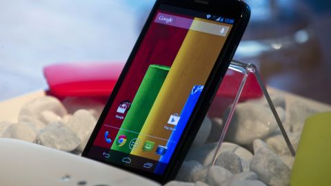 """Google, Android. The new low cost smartphone of Motorola, """"Motorola Moto G"""", is displayed in Sao Paulo, Brazil on November 13, 2013. The smartphone, with dimensions 65.9mm W x 129.9mm H x 6.0 - 11.6mm D is equipped with a Qualcomm Snapdragon 400 with quad-core 1,2 GHz CPU, a 4.5-inch display and Android Operating System 4.3 and a suggested price of $ 179 USD. AFP PHOTO / NELSON ALMEIDANELSON ALMEIDA/AFP/Getty Images"""