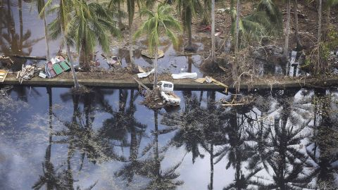 A truck lies in the water in Hernani, Philippines, on November 14.
