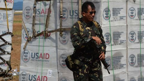 A Philippine soldier guards U.S. aid at the Tacloban airport on November 15.