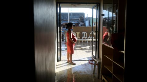 A pregnant survivor waits to give birth in a hospital November 16 in Tanauan.