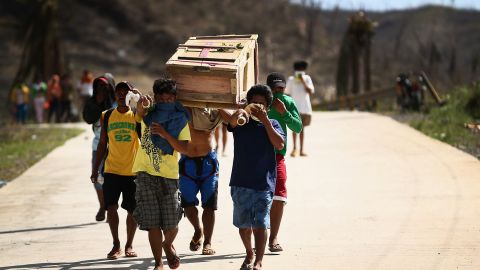 Men carry a coffin toward a Leyte cemetery on November 16.