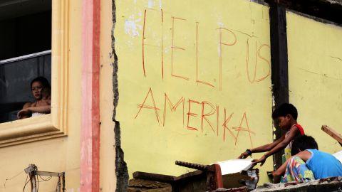 Survivors appeal for U.S. help November 16 in Tacloban.