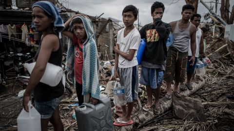 People wait in line for drinking water November 17 in Palo, Philippines.