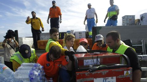An emergency team from Spain unloads relief supplies November 17 in Tacloban.