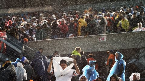 Fans begin to clear the stands during the rain and high winds at Soldier Field in Chicago on November 17.