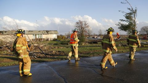 Firefighters survey the damage at Mintonye Elementary School in Lafayette, Indiana, on November 17. A series of strong thunderstorms pounded Tippecanoe County, northwest of Indianapolis, on Sunday.
