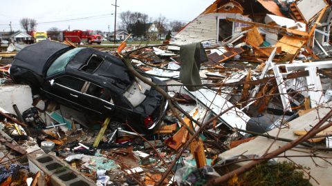 A car sits among the debris of a leveled home in Kokomo, Indiana, on November 17.