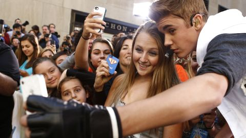 """Singer Justin Bieber takes a selfie with a fan before appearing on NBC's """"Today"""" show."""
