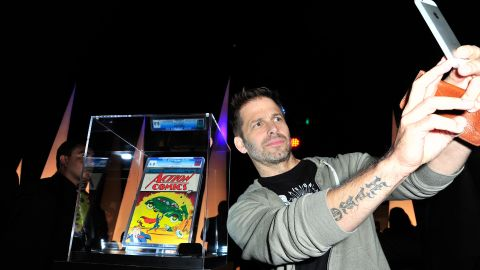 Selfies don't always have to be with other people. Director Zack Snyder takes a photo of himself in front of Action Comics No. 1 at the Superman 75 party in San Diego.