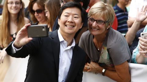 """Actor Ken Jeong takes a photo with a fan before appearing on NBC's """"Today"""" show."""