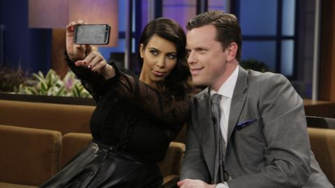 """Television personalities Kim Kardashian and Willie Geist take a selfie during """"The Tonight Show with Jay Leno."""""""