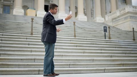 Rep. Sean Duffy, R-Wisconsin, shoots a video selfie for his Facebook page before the start of a House GOP news conference in Washington.