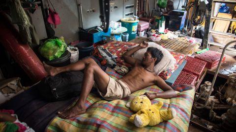 A man sleeps on Tuesday, November 19, on a tanker that ran aground during Typhoon Haiyan in Tacloban.