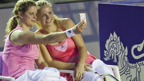 Now-retired tennis player Kim Clijsters takes a selfie with Caroline Wozniacki during an exhibition match in Hua Hin, Thailand.