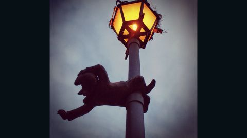 An ornamental gnome clings to a lamppost. Wroclaw is famed for the tiny statues that can be found dotted across the city, often in unusual locations.