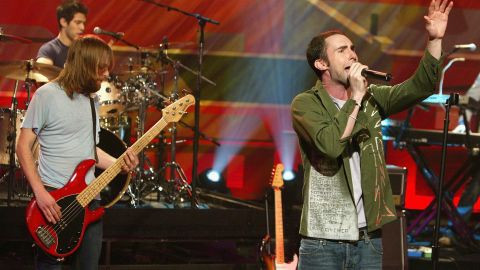 """Levine performs with Maroon 5 on """"The Tonight Show with Jay Leno"""" in Burbank, California, in 2004."""