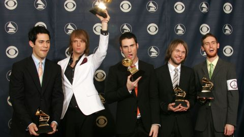 """Levine and Maroon 5 pose with their awards for """"Best New Artist"""" during the 2005 Grammy Awards in Los Angeles."""