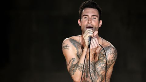 """Levine sings during the Maroon 5 video shoot for their song """"Moves Like Jagger"""" in Los Angeles in 2011."""