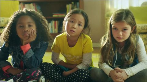 """The ad features 3 girls creating a """"Rube Goldberg"""" contraption."""