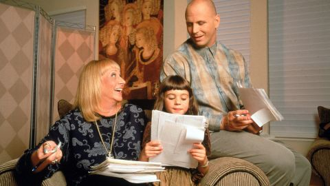 """Renowned psychic <a href=""""http://www.cnn.com/2013/11/20/showbiz/sylvia-browne-dies/index.html"""">Sylvia Browne</a>, a leader in the paranormal world who appeared regularly on television and radio and also wrote dozens of top-selling books, died November 20 in a northern California hospital, according to her website. She is pictured here with her granddaughter Angelia and son Christopher."""