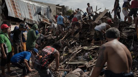 Filpinos clear rubble from a hard-hit area in Tacloban on November 22.