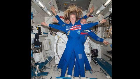 NASA astronaut Karen Nyberg takes a selfie with Russian cosmonaut Fyodor Yurchikhin and European Space Agency astronaut Luca Parmitano behind her.