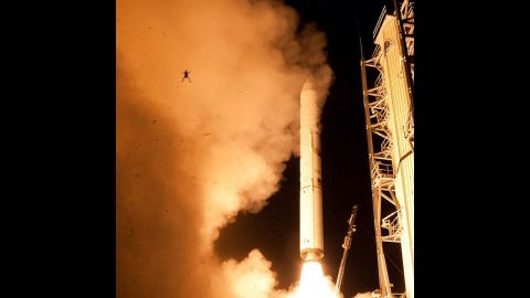 """There it goes! A still camera on a sound trigger captured this intriguing photo of an airborne frog in the foreground as NASA's  Lunar Atmosphere and Dust Environment Explorer spacecraft lifts off toward the moon. This <a href=""""http://www.cnn.com/2013/09/12/tech/innovation/frog-and-rocket/"""">foreground photobomber stole the show</a>, earning this snap almost 25,000 likes."""