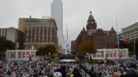 Dallas Mayor Mike Rawlings speaks November 22 at Dealey Plaza, a few feet away from where Kennedy was fatally shot 50 years ago.