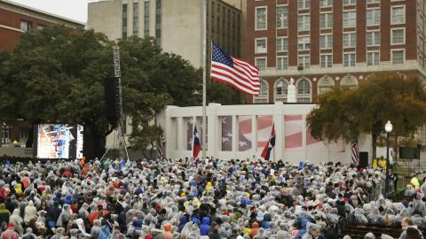 """People gather at Dealey Plaza on November 22. """"A new era dawned and another waned a half century ago when hope and hatred collided right here in Dallas,"""" Rawlings said in his remarks."""