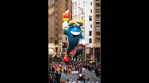 <strong>Izzy (1993):</strong> Izzy, the mascot for the 1996 Olympic Games, carries the Olympic torch.