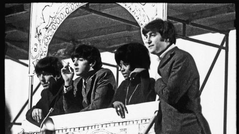 """Within a year of """"Please Please Me,"""" the Beatles had performed before 75 million Americans on <em>The Ed Sullivan Show</em> and flown home to film <em>A Hard Day's Night </em>and record <em>Around the Beatles.</em>"""