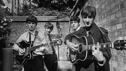 """The Beatles take a break in the back yard of Abbey Road while recording their first hit """"Please Please Me"""". <br /><br />Acclaimed British photographer Terry O'Neill built his reputation capturing the spirit of the Swinging Sixties. Here he gives a sneak preview of rare and unseen shots from his forthcoming London exhibition """"1963: Year of the Revolution""""."""